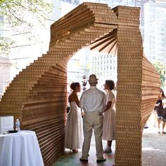 Twelve couples tied the knot beneath a temporary cardboard arch by Z-A Studio in New York's Central Park at the end of last month.