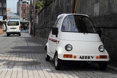 This very small car, 'ABBEY Carrot', seen on a street in Kyoto, Japan, has an eco-friendly YAMAHA-50 cc Engine ..... www.takeoka-m.co.jp/abby.html