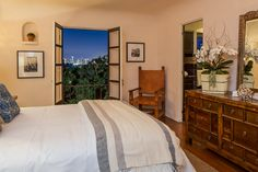 The only thing better than a cozy bedroom is dreamy skyline views of LA from the window.