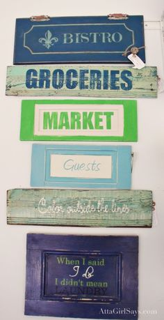 Painted signs on a variety of wooden backdrops.