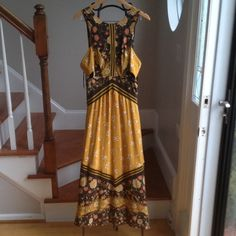 Free People maxi dress Double layer fabric keeps this dress from being to sheer. Small cut outs on each side. Zips up back with hook n loop closer. Free People Dresses Maxi
