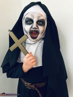My daughter Aubree loves scary movies and wanted to be Valak from the movie The Nun. We made the entire costume out of our own personal items and clothing. We painted her face to look just like Valak. The costume was a big hit and. Scary Girl Halloween Costumes, Homemade Halloween Costumes, Halloween Costume Contest, Halloween Costumes For Girls, Halloween Dress, Diy Halloween, Halloween Makeup, Costume Ideas, Halloween Decorations