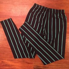 """$1 if bundled Black/blue soft full length tights. Long printed striped tights. Soft cottony material. Tag says """"one size""""  they fit a medium well.  Pants Leggings"""