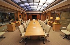 The Good Wife boardroom. The cream colored conference room chairs are available from Arenson's Office Furnishings in NYC. Contact Richard Slavin at 212-564-8383.