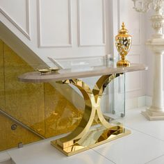 Create a statement with the 24 Carat Gold and Lacquer Designer Console Table, striking in any interior. Express yourself.