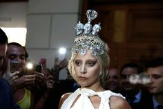 """On Friday 19 of September Lady Gaga appeared outside hotel Grande Bretagne wearing the Kondylatos crown Saturday 20 of September Pericles Kondylatos send flowers at her hotel room and a """"thank you"""" note for her. The same day Lady Gaga took a picture of the flowers and & she posted it on all of her social media : """"The crown I wore yesterday was made by a fan, how sweet today they sent me some flowers and a note. What a lovely way to start the day. The pleasure is mine my darling. #LadyGaga"""""""