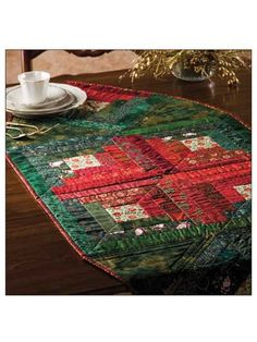 """Use Christmas scraps for an easy runner!   This beginner pattern can be made in a weekend and uses leftover scraps! Finished size is 58"""" x 24""""."""