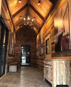 "We know what you're thinking. ""Whoa! That's a lot of wood."" And you're right. It IS a lot. But it's the entrance to our showroom and we tend to think along the same lines of the old saying ""You can't trust a skinny chef."" Our Mushroom Wood Hardwood Blend Distillery Pine and Original Saw Mark Oak make up this cornucopia. #beams #paneling #specialtymillwork Residential Interior Design, Commercial Interior Design, Commercial Interiors, Reclaimed Wood Paneling, Wood Beams, Stair Treads, Mantles, Distillery, Showroom"