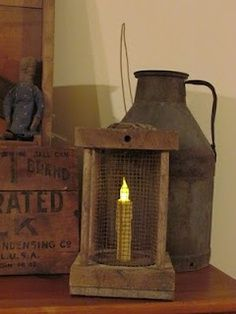 *Sigh!*  Oh, I WANT a tin jug like this one!!!  I love the lantern too! :-)   ---Prim lamp~Tin Jug