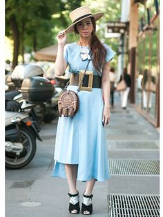 Ploy Chava wearing a Celine hat and belt, Chanel necklace, Miu Miu bag and Topshop dress