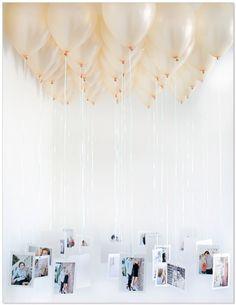 Fotos suspensas, podem ser balões coloridos, decorar com tule, etc sala da minha mãe