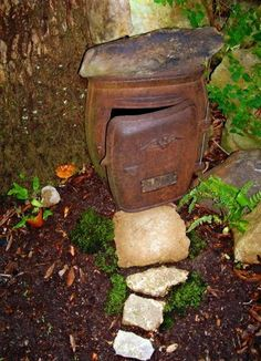 Fairy house... I really like the idea of having these in the garden.  What a great way to re-purpose old wood stoves!  I have 3.  Yes.  3.