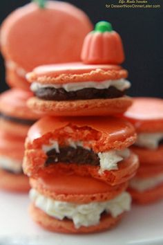 Pumpkin Pie Spice infused macarons are filled with Pumpkin Spice Dark Chocolate Ganache and Pumpkin Buttercream Frosting giving these triple the pumpkin!  Recipe by @lifemadesweeter for DessertNowDinnerLater.com