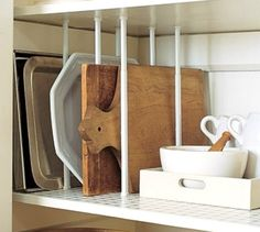 s 13 incredibly useful tension rod ideas you haven t seen yet, crafts, organizing, repurposing upcycling, Keep cutting boards and trays in line