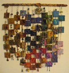 DON'T try to click the link...but it looks like small, individual quilted squares put together on twine or string with beads on a covered dowel...and I might JUST find a way to do something like it.