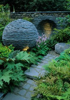 Harpur Garden Images Ltd :: mc05309 Silver. Lakeland slate ball. Ferns. Niche in wall. Lighting. decorative modern Design: Andrew Loudon. The Philosophers Garden Contemporary Small gardens Walls Paths Ornaments Lighting Marcus Harpur Please read our licence terms. All digital images must be destroyed unless otherwise agreed in writing. Photograph by: www.harpurgardenlibrary.com Contact: Harpur Garden Library 44 Roxwell Road Chelmsford Essex CM1 2NB, UK