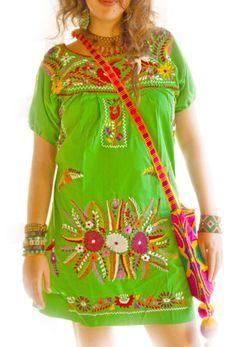 Aida Coronado embroidered Mexican dresses and tops