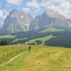 Alpe di Siusi (Seiser Alm) with Sassolungo (Langkofel) in the background. Dolomites, South Tyrol, Italy.