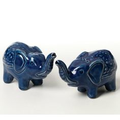 Blue Elephant Salt And Pepper Shakers When an elephant's trunk is raised it means good luck. Sprinkle good fortune into your dishes with these adorable ceramic salt and pepper shakers. One shaker has a single hole and the other has three holes. Elephant Trunk, Elephant Love, Elephant Stuff, Elephant Party, Collor, Salt And Pepper Set, Salt Pepper Shakers, Tea Pots, Pottery