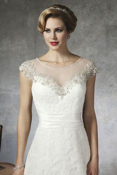27bb062aa3cb Justin Alexander net mesh bodice with beading and applique detail on sheath  of dress