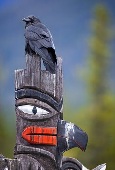 could be Duncan BC where totem poles fill the street with Art  and History.  (Ali)