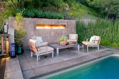 This stucco-framed fireplace by JWT Associates shows that the ribbon concept isn't limited to the interior. Fire meets water in this outdoor...