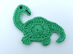 1 Crochet applique green Brontosaurus dinosaur. This cute little dinosaur measures 3 ins (7.5cms) long and 2¼ ins (5.5cms) tall. This applique can be ordered in any colour. It can be used for a wide variety of craft projects including fabric applique and embellishments for cards and scrapbooks. It would be perfect to decorate skirts, blouses, sweaters, hats, scarfs, bags, gloves, baby clothes, childrens clothes, accessories, cushions, pillows, home decor projects etc. Hand crochet in 100%…