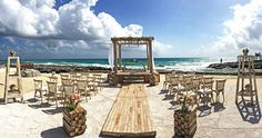 Hard Rock Riviera Maya Wedding Setup.  Pin this for a rustic look at your beachside wedding.  This isn't one of the packages you can choose.  The bride and the wedding coordinator made this style come together.
