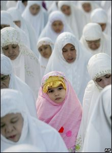 A Muslim girl takes part in a morning prayer marking the start Eid al-Fitr in Jakarta, Indonesia