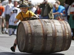Oktoberfest Zinzinnati: 6 things to know. Photo: Christopher Harten steals the show before the keg races at the 2011 Oktoberfest on Fountain Square. The Enquirer/Glenn Hartong