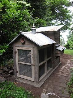 Even a chicken coop exudes rustic charm with its cupola, metal roof and screened run. The screens come nearly to the ground to help circulate air and give the birds a view to the garden.