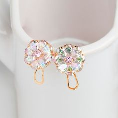 Truly exquisite crystal and gold flower earrings. Crystal flowers delightfully glimmer, changing color in the light, and gold-colored plate adds class and luxury. These earrings would make a gorgeous addition to nearly any wardrobe.