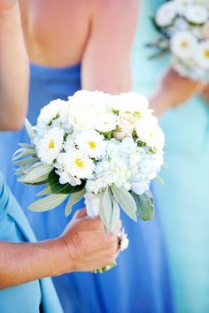 bridesmaids in shades of blue; flowers in blue and white