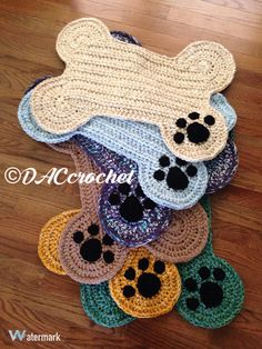 CROCHET PATTERN ONLY for a dog bone floor place mat; 2 sizes included. Includes written directions in US terms. All sizes of hats and clothing are based on standard sizing charts. Standard size easily accommodates 2 small or medium food/water bowls Larger size easily accommodates up to 3