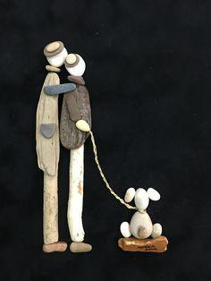 Pebble art and driftwood gülen