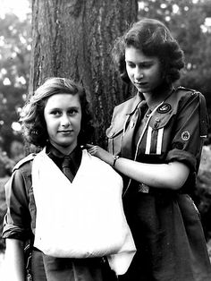 And undated photo of Princess Elizabeth and her sister Princess Margaret show them both wearing girl guide uniforms, Margaret with her arm in a sling.