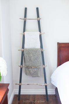 Love this DIY blanket ladder made with driftwood, copper tube clamps and 2x2's ! Such a great coastal or farmhouse decor idea! Step-by-step tutorial included. #ad #CDNsummer #CollectiveBias