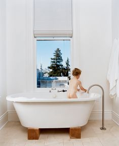 Jonathan Nelson's one wish for the master bathroom was for views from the Zuma tub. He got that and then some, and now three-year-old Jonas (pictured) and his older brother refuse to bathe anywhere else. The stand-alone faucet is by Lefroy Brooks from the XO collection.