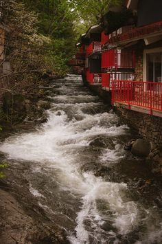 This Roaring Fork, Tennessee Photography features a gorgeous scene nestled behind one of most memorable hotels in Gatlingburg. The beautiful Roaring Fork Creek rambles down the rocky terrain from the