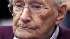 A court upholds the conviction of Auschwitz guard Oskar Groening, in a major reversal of German policy.