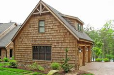 This traditional inspired two car garage has a rustic look to its exterior because of the shingle siding and shaker siding on the walls.