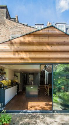 Timber battens cladding around the slimline aluminium doors. Garden & kitchen are seamlessly connected in this gabled rear extension in Hackney. Wood Cladding Exterior, Larch Cladding, Timber Battens, Modern Exterior, Exterior Design, Gable Decorations, Rear Extension, Extension Ideas, Gable House