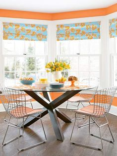 Orange and turquoise in a dining nook. Bright and cherry. home decor, interior design, mecdesignstudio, dining rooms