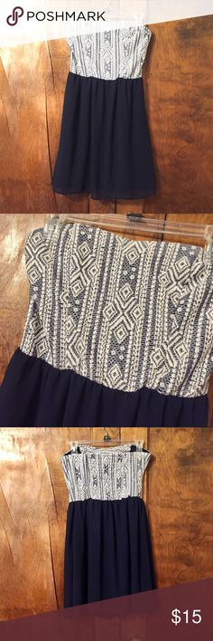 Navy blue dress Navy blue dress with off white tribal/aztec design on the top. Strapless. Great to wear to attend a wedding. Never worn, bought and it's the wrong size. Xhilaration Dresses Strapless