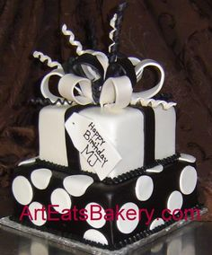 Google Image Result for http://arteatsbakery.com/images/Two%2520tier%2520square%2520black%2520and%2520white%2520polka%2520dot%2520fondant%2520birthday%2520presents%2520cake%2520with%2520sugar%2520bow%2520and%2520ribbon%2520curls.jpg