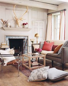 classic and contemporary living room.  deer bust, floor pillows, and trim detail.  domino