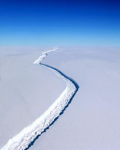 Today it has been reported that an iceberg — roughly twice the size of Luxembourg —separated from the Larsen Ice Shelf in Antarctica. This photograph from January shows a massive fracture in the ice that measured more than 100 feet wide and over 100 miles long at the time. It is estimated that this chunk weighs roughly one trillion tons and the break could lead to a rise in global sea levels by roughly four inches (10 centimeters). ///Photo by John Sonntag for @NASA Save The Arctic, Ice Sheet, Save Our Oceans, White Spirit, Exploration, Image Of The Day, Tonne, Aerial Photography, Wilderness