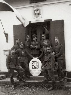 1938 Partition of Czechoslovakia - Polish Army soldiers taking a group pose after replacing the Czechoslovak coat of arms with the Polish coat of arms over the Ligotka post office.
