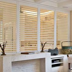 Blinds.com: Track Fauxwood Shutter. I like this idea for a sliding glass door but need to see better pix