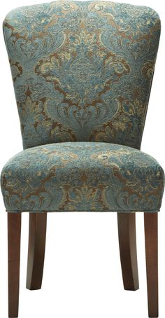 Stately dinner seating. (The Harman Dining Chair in Arhaus' (blue) Nile fabric selection.)
